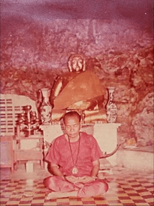 Ajarn Chum Chai Kiree meditating inside the sacred cave at Khao Or