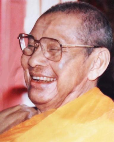 Luang Por Ruesi Ling Dam Laughing